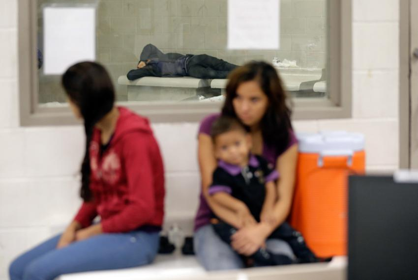 Immigration detainees wait at a U.S. Customs and Border Protection processing facility in Texas.