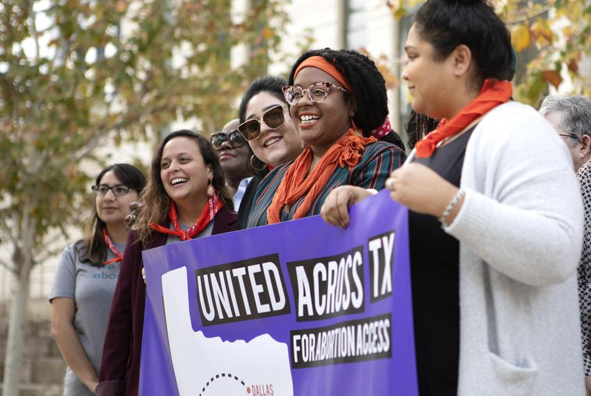 Abortion access advocates pose for a photograph outside of  the U.S. District Court in Austin. The court is set to weigh i...