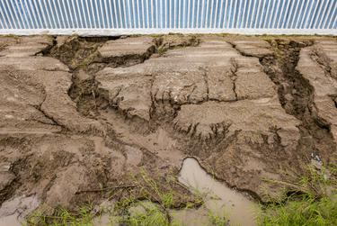 Tommy Fisher, CEO of the firm that built the 3-mile stretch of border fence south of Mission, said this kind of erosion is to be expected, given the rainfall and the fact that the grass that was added has not grown in the area by the fence.