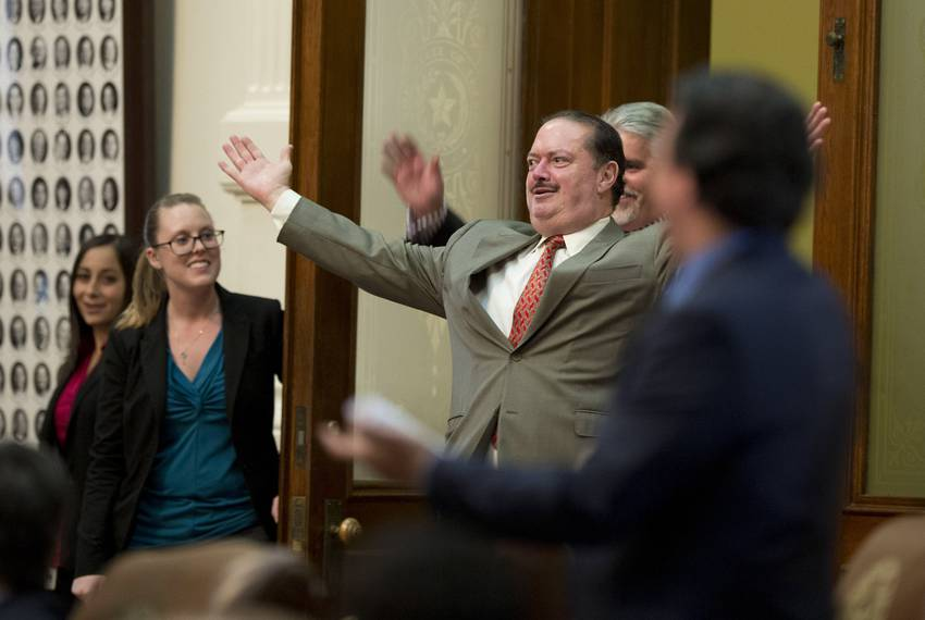 11:14 p.m.— State Rep. Rene Oliveira, D-Brownsville, enters the chamber during a vote verification.