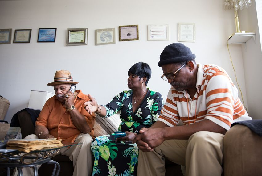 Leon Phillips, Rosalyn Jackson and her father, Martin Jackson, left to right, in Martin Jackson's apartment at Cedars at Carver Park in Galveston, Texas. The apartment is part of a mixed-income development built to replace some of the island's destroyed public housing.