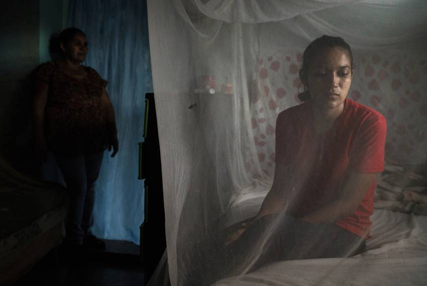 Claudia and her mother, Suyapa, in their home in Olancho, Honduras. Claudia is experiencing what her mother went through when her oldest son migrated to the...