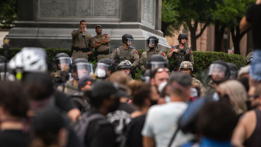 A crowd of protestors gather at the south gate of the capitol on May 31, 2020