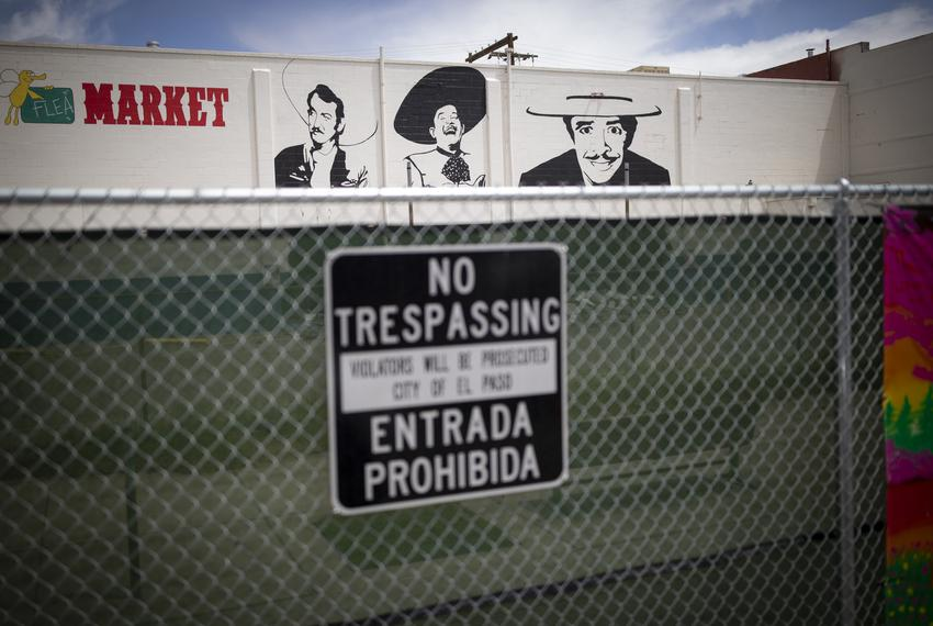 Seen is fencing blocking off the public from vacant buildings in the Duranguito neighborhood, Wednesday, April 17, 2019, i...