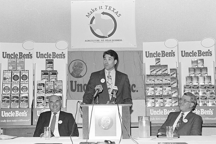 Rick Perry in 1991 at Uncle Ben's rice offices in Houston to promote his Make It Texas initiative. The program was designed …
