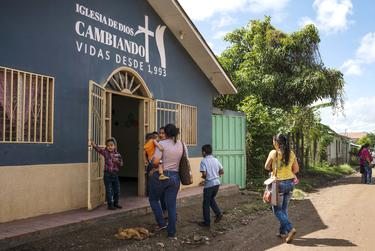 Claudia and her family attend Sunday church in Olancho, Honduras. She says that listening to the Lordís word helps her deal with her current situation.