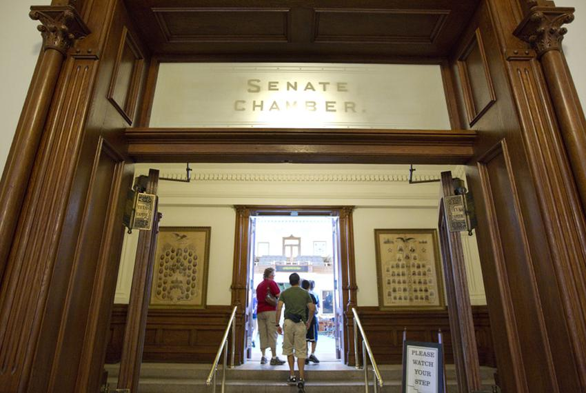 Tourists enter the empty Senate chamber Wednesday morning as the Texas Senate adjourned sine die the day before, leaving the…