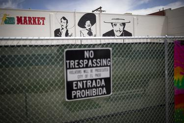 Seen is fencing blocking off the public from vacant buildings in the Duranguito neighborhood, Wednesday, April 17, 2019, in El Paso, Texas. Photo by Ivan Pierre Aguirre for The Texas Tribune