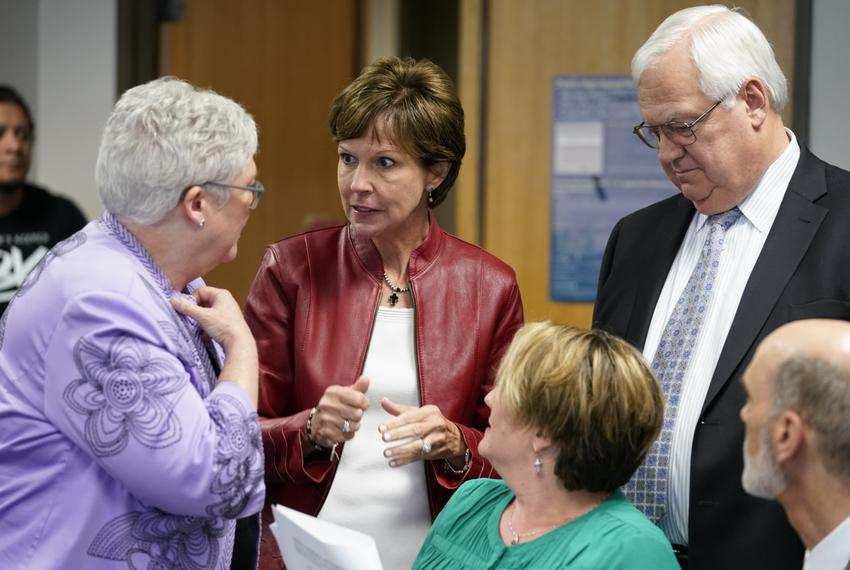 State Board of Education member Barbara Cargill speaks with spectators during a break in the State Board of Education meet...