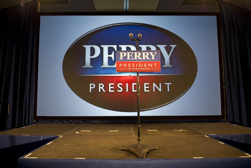 The empty stage at the West Des Moines Sheraton after Rick Perry announces that he'll return home to Texas to reassess his p…