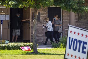 Voters enter a polling site at Ben Hur Shrine Center on Tuesday, July 14, 2020 in Austin.