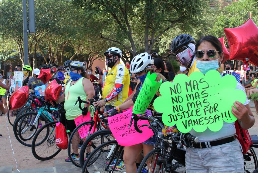 """Irma Ramos holds a sign that says, """"No mas,"""" at a vigil for slain Army Specialist Vanessa Guillén at the San Fernando Cathed…"""