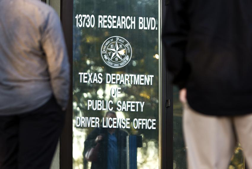 A line begins to form outside the DPS office in Northwest Austin shortly before it opens at 8 a.m. on Jan. 24, 2019.