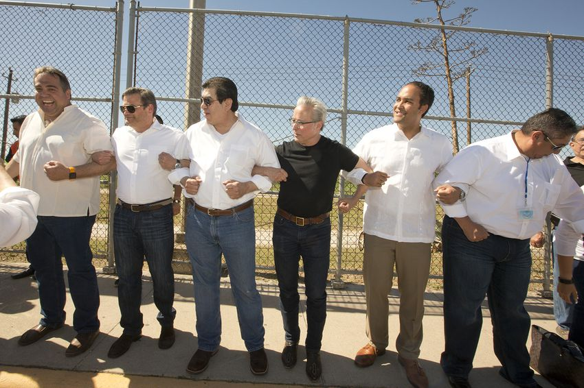 Local dignitaries, including (l.-r.) Héctor Arocha, mayor of Ciudad Acuña, Mexican Consul Carlos Gustavo Obrador Garrido Cuesta, Roberto Garza, mayor of Del Rio, Texas, country music singer Radney Foster and U.S. Rep. Will Hurd, R-Helotes, form a human chain on the International Bridge between Ciudad Acuña, Coahuila and Del Rio, Texas during the Border Unity Rally on March 25, 2017.