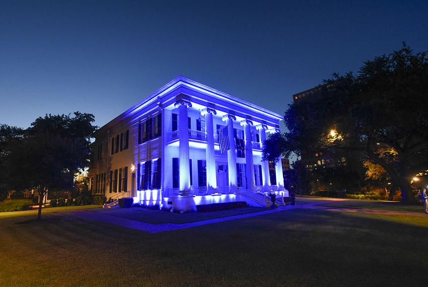 The Texas Governor's Mansion is bathed in blue light at sunset July 8, 2016 as Texans honor five slain police officers in ov…