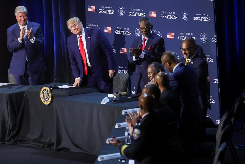 U.S. President Donald Trump watches as Secretary of Housing and Urban Development Ben Carson gets a standing ovation after...