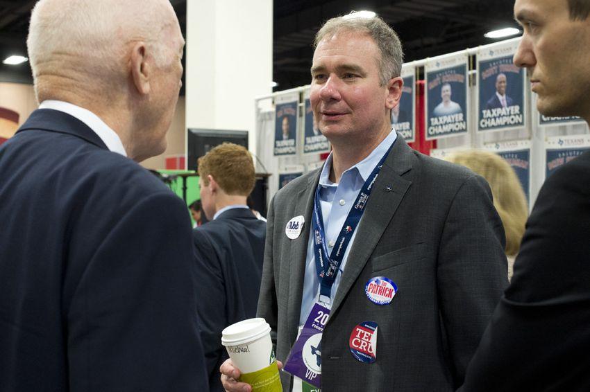 Republican activist Michael Quinn Sullivan visits at the State Republican Convention trade show on June 6, 2014.