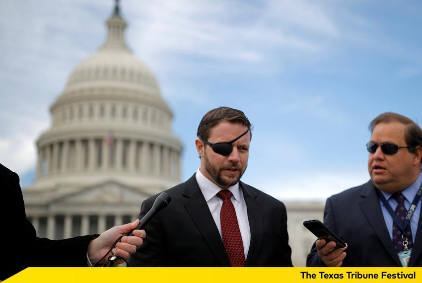 U.S. Rep. Dan Crenshaw, R-Houston, speaks with reporters as he arrives for a class photo with incoming newly elected membe...