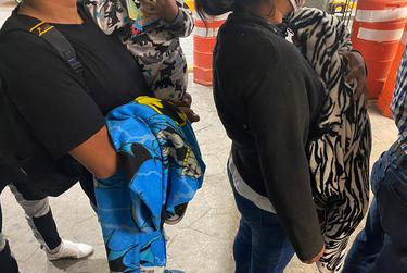 Migrants and asylum seekers line up on the Juárez side of the international bridge, seeking answers about when they'll be able to appear before U.S. immigration judges.