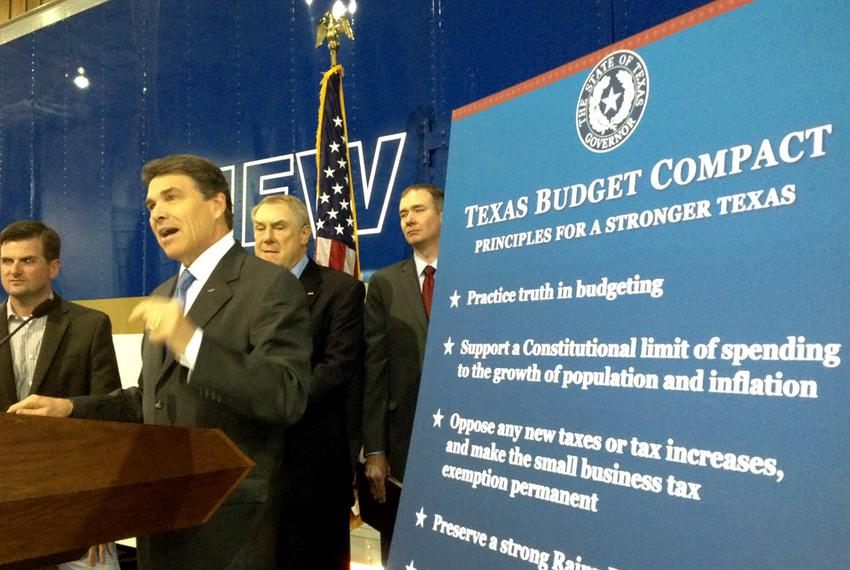 "Gov. Rick Perry unveils his ""Texas Budget Compact"" in Houston on Monday, April 16. On stage with Perry, from left to right: …"
