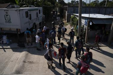 More than 50 migrants, all Honduran with the exception of one Guatemalan, walk to the nearest train station on Oct. 26, 2018, near Palenque, Chiapas. The group will be heading north by traveling on freight trains through México. They decided to travel as a group to be better protected from thieves, police, and Mexican immigration officers. Some say they will eventually join the migrant caravan that is currently traversing México with around 4,000, while others say it is better to do it in small groups. At least 800 more troops will be deployed to the U.S.-Mexico border as the migrant caravan keeps traveling north.