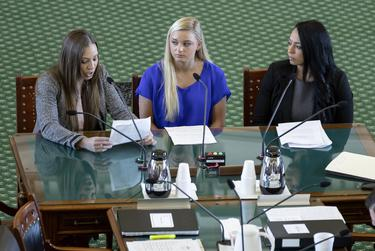 From left: Jordan Schwikert, Alyssa Baumann and Tasha Schwikert, three gymnasts who say they were abused by Larry Nassar, testify on HB 3809 during the Senate State Affairs Committee on May 13, 2019.
