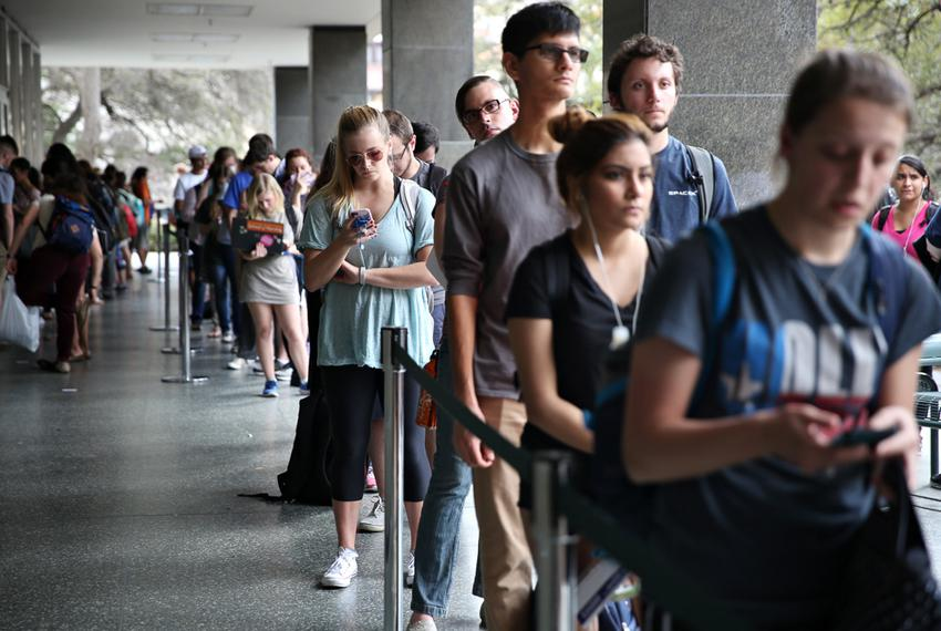People stand in line to vote for the primaries at the Flawn Academic Center on the University of Texas campus on March 1, ...