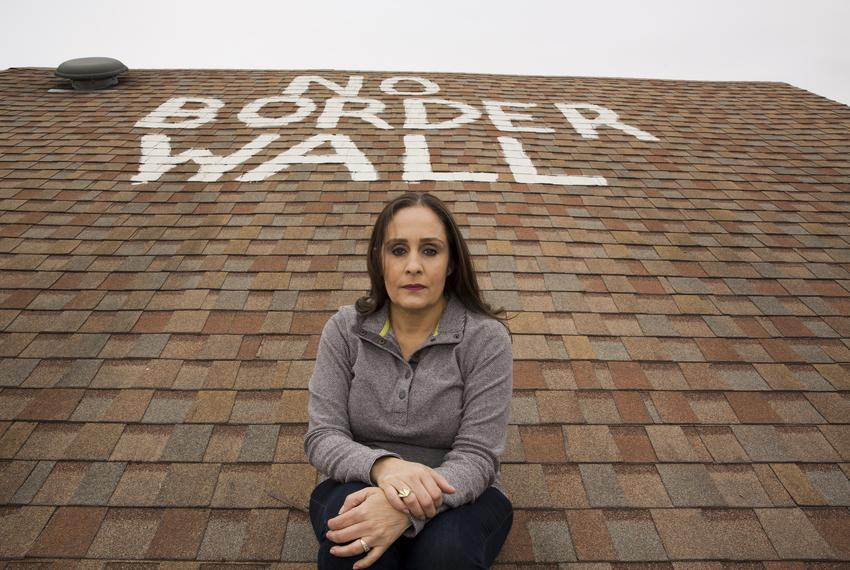 "Naida Alvarez painted ""no border wall"" on the roof of her home in La Rosita, Texas. Alvarez has received letters from the ..."