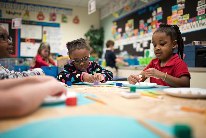 Tatum Roberts, left, and Olivia Mah work on toothpick cubes in Melanie Martin's kindergarten class at Johnston-McQueen Elementary.