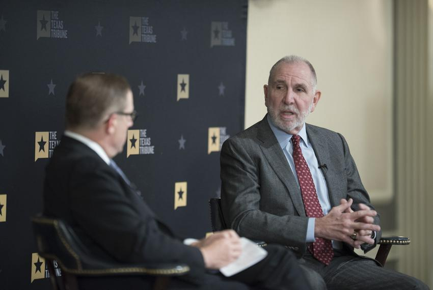 Texas Tribune CEO Evan Smith interviews Texas A&M President Michael Young during a Tribune event on Dec. 1, 2016.