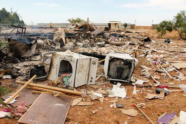 A clothes dryer in the wreckage of the Tercero family home outside Midland.