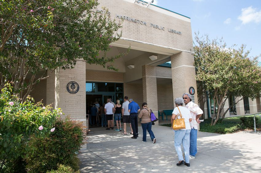 Voters line up outside Harrington Library in Plano, Texas, on the first day of early voting on Monday, Oct. 24, 2016.