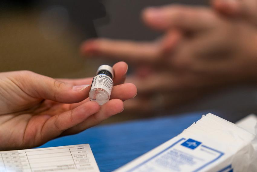 A vial containing the Pfizer-BioNTech CODID-19 vaccine is prepared to be administered to health care workers at the UT Healt…