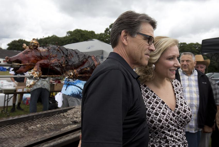Gov. Perry poses with retired United States Marine Corps Sgt. Jessie Jane Duff at the Defend Freedom Pork Roast in Rochester…