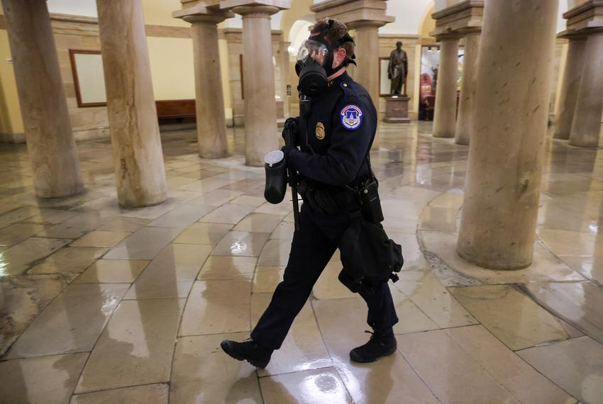 A member of the U.S. Capitol Police walks inside the Capitol as supporters of U.S. President Donald Trump protest in Washing…