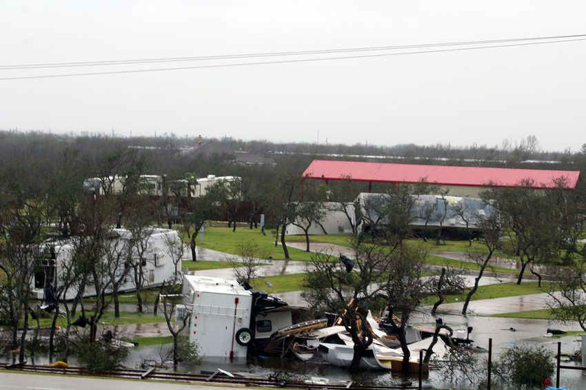 Rain soaked damaged and overturned recreational vehicles at Paradise Lagoons RV Resort in Aransas Pass on August 26, 2017, the day after Hurricane Harvey barreled through southern Texas.
