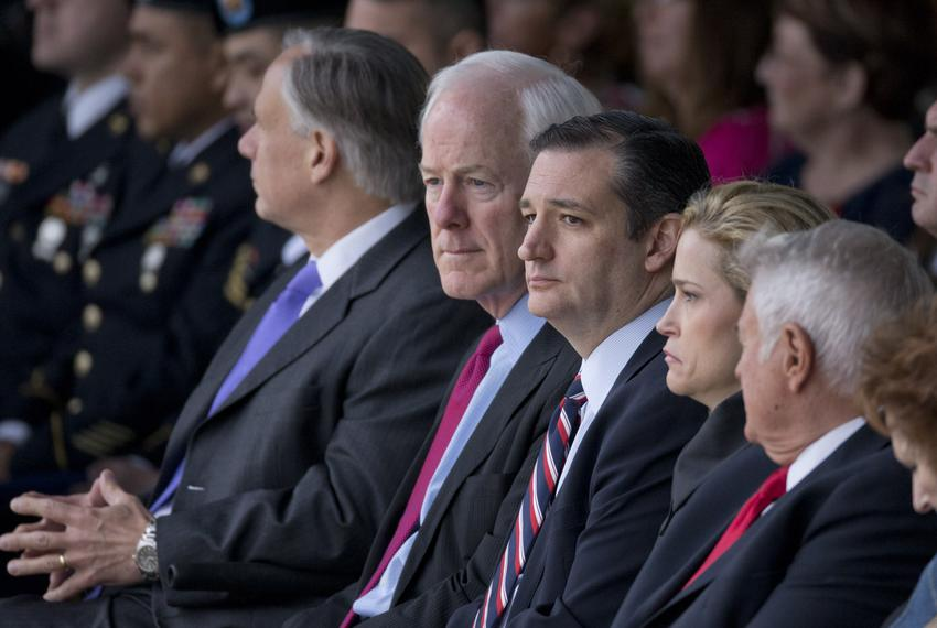U.S. Sen. John Cornyn sits with U.S. Sen. Ted Cruz and wife Heidi Cruz at the Fort Hood Purple Heart ceremony on April 10, 2…