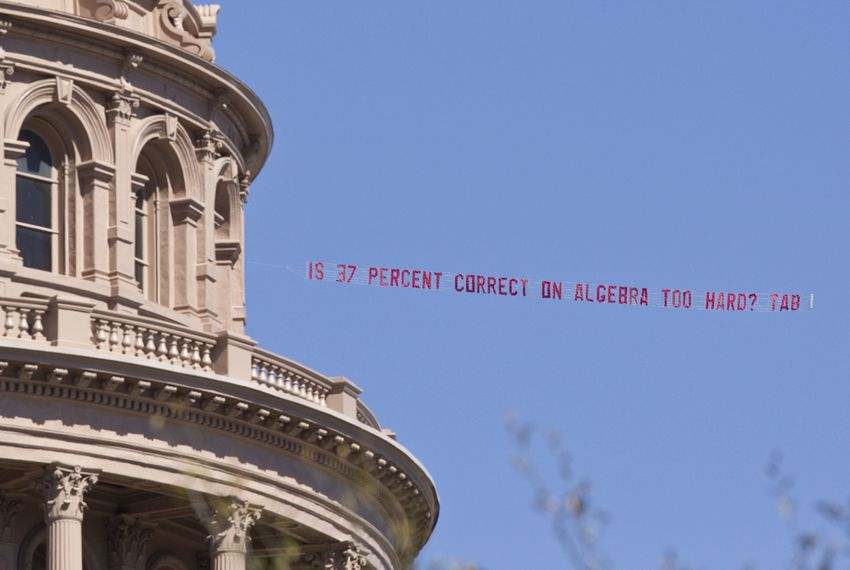 """Airplane buzzed over the Capitol during the lunch hour with banner from the Texas Association of Business asking """"Is 37 % correct on algebra too hard?"""""""