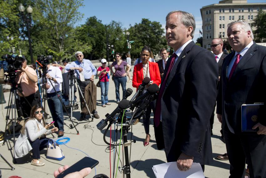 Texas Attorney General Ken Paxton hold a press conference in front of the Supreme Court on Thursday, June 9, 2016.