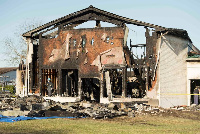 The FBI, ATF and other agencies sift through the burned remains of the Victoria Islamic Center a mosque in Victoria on Jan. …
