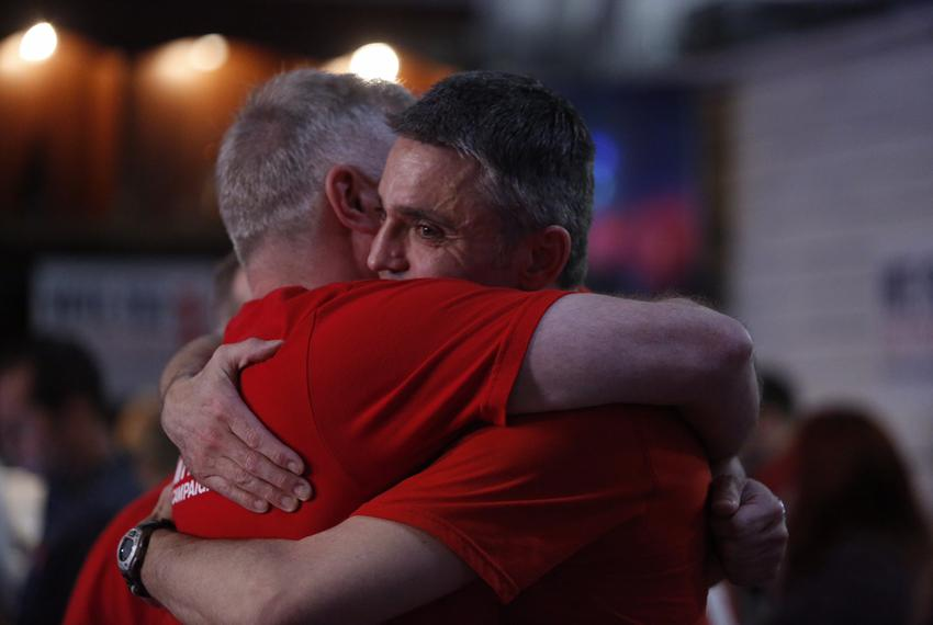 Supporters of Houston's Proposition 1 hug on election night in Houston, Texas on Nov. 3, 2015.