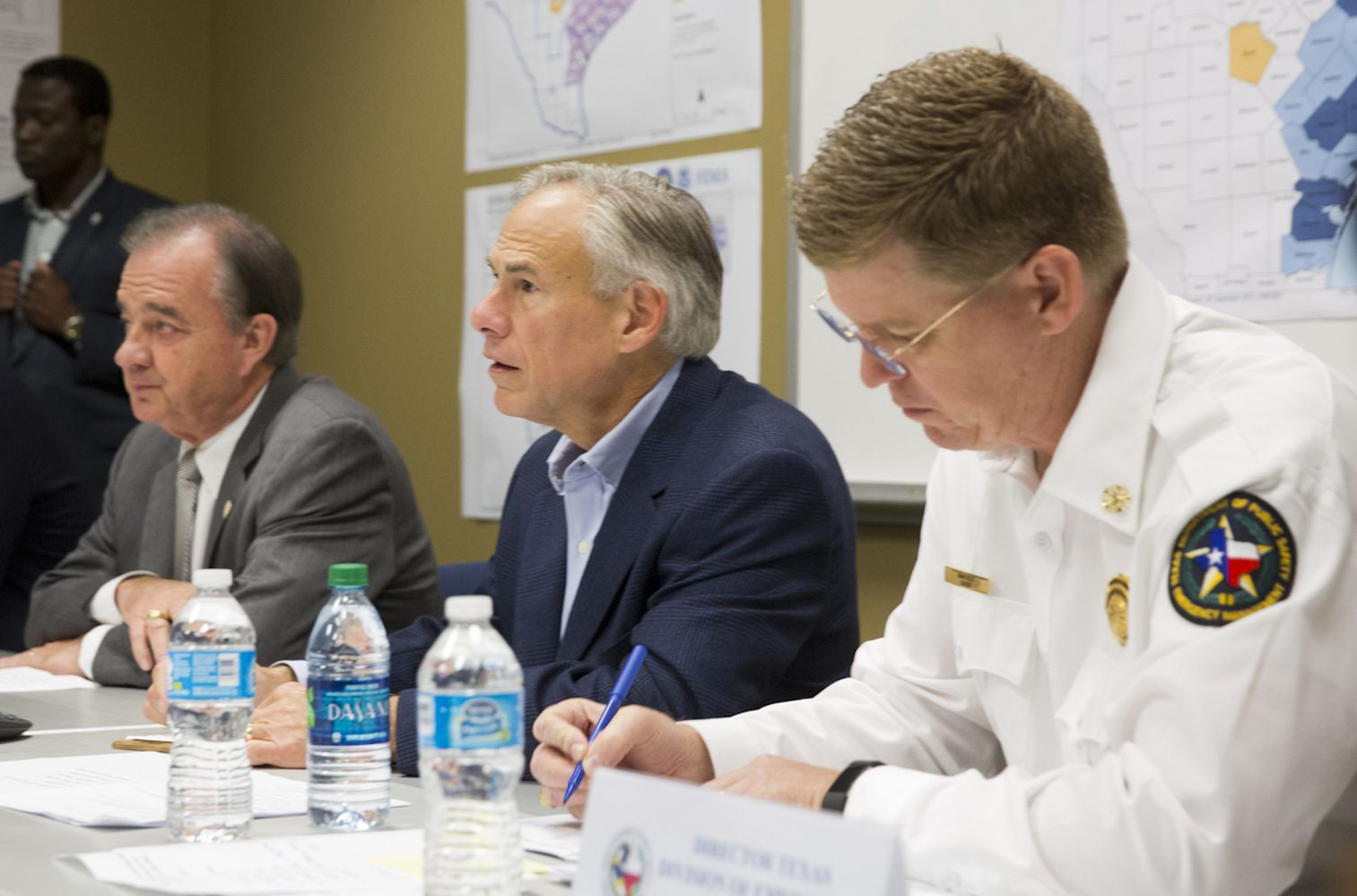 John Sharp, Texas A&M University chancellor and head of the new Governor's Commission to Rebuild Texas, Gov. Greg Abbott and Nim Kidd, Chief of Texas Emergency Management, get briefed on recovery efforts after Hurricane Harvey at the FEMA Joint Field Office in Austin on Sept. 14, 2017.