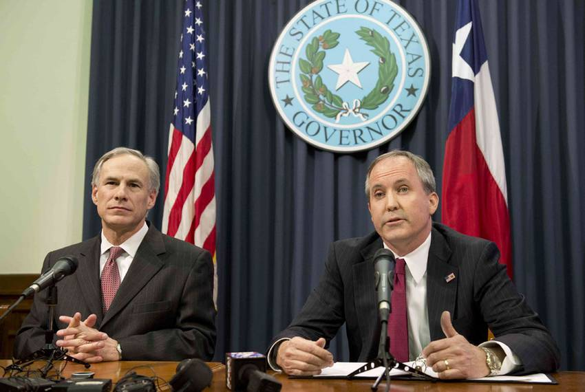 Texas Gov. Greg Abbott, l, with Attorney General Ken Paxton at a Capitol press conference on Feb. 18, 2015.