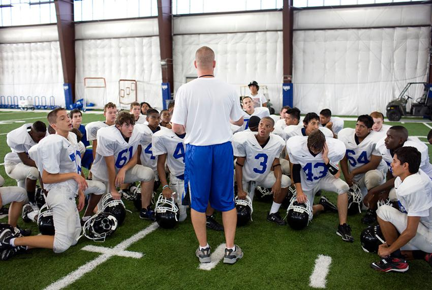 Students at North Forney High School work through football practice on the first day of school in Forney, Texas, in August...