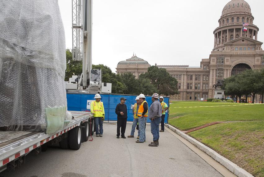 Sculptor Ed Dwight talked with workers who were installing the Texas African-American History Memorial Monument at the Tex...