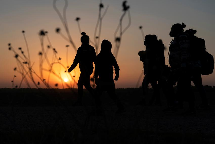 Asylum-seeking migrants' walked towards the border wall after crossing the Rio Grande into the United States from Mexico, in…