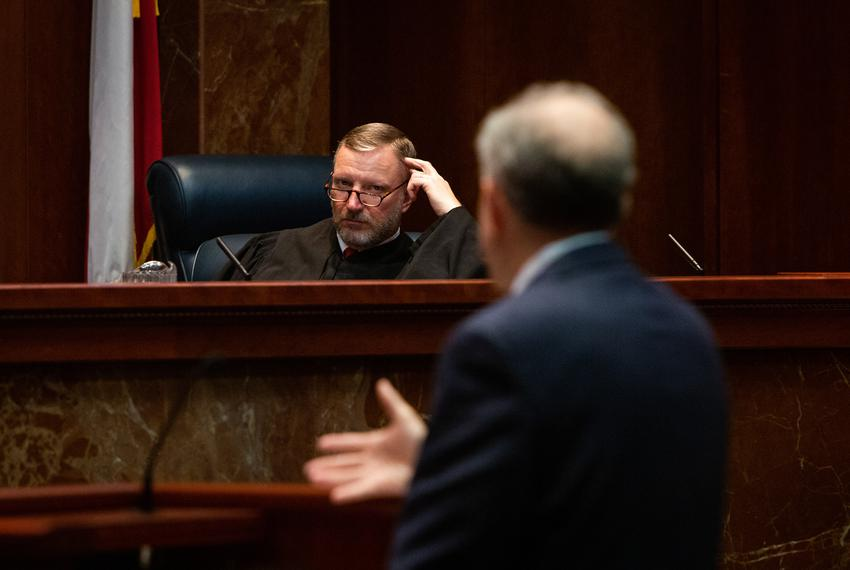 Texas Supreme Court Justice Jeff Brown listens to Philip Durst during a hearing for the Texas Department of Criminal Justi...
