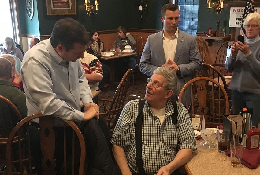 U.S. Sen. and presidential candidate Ted Cruz talks to a voter in Wisconsin ahead of that state's Tuesday primary on April 3…
