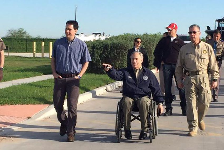 Texas Gov. Greg Abbott and Wisconsin Gov. Scott Walker tour the U.S.-Mexico border Friday. Walker is a likely 2016 presidential candidate.