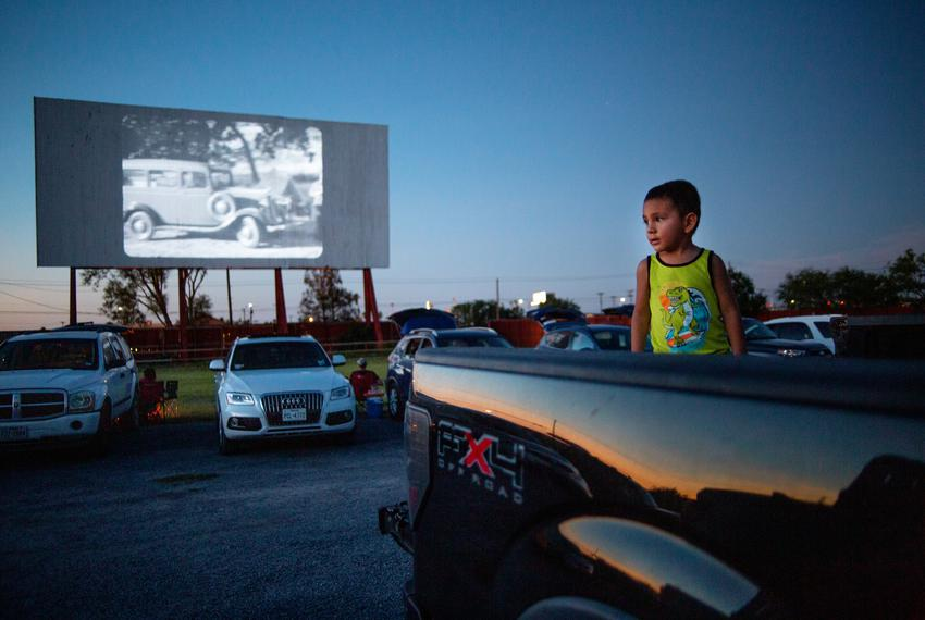 Ciro Castorena's son looks towards the sunset before the Friday night movie at the WesMer Drive-In Theatre in Mercedes on Ju…